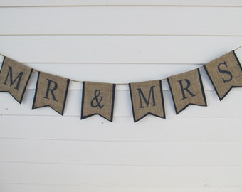 """Rustic Burlap """"Mr & Mrs"""" Wedding Banner Shown with Navy Blue Lettering and Outline"""