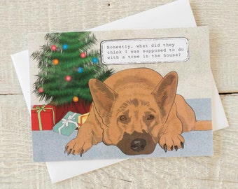 Holiday funny dog greeting card, tree in the house, dog lifting leg on tree, German Shepherd, potty in the house, Christmas