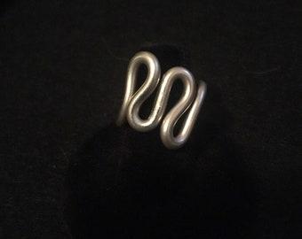 Ajustable mixed metal ring