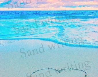 Blue heart sand writing
