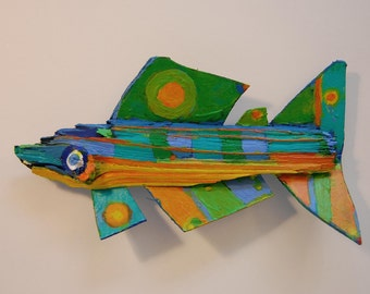 "The 8 inch long ""Stream Lined"" Wood Fish was created from driftwood found in Western NY and painted with bright color"