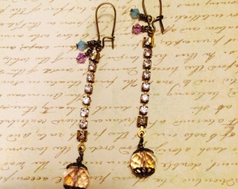 Feeling Shiny dangle earrings. Swarovski crystal cup chain hangs from AGP brass leverbacks. Additional swarovski crystals dangle from bottom