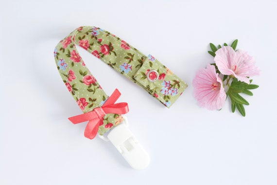 Green floral dummy/ pacifier clip with pink satin bow