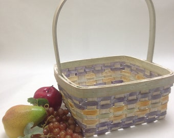 "sweet medium large wicker basket, pastel purple yellow accent, garden kitchen farmhouse cottage; 10"" wide, 4.5"" deep, 13"" tall, yesteryears"