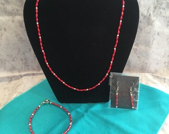 Red rice imitation pearl necklace set.