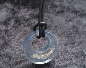 Transparent blue epoxy pendant with silverfoil