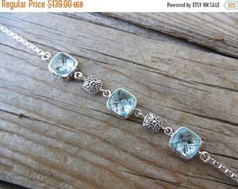 ON SALE Beautiful sky blue topaz bracelet handmade in sterling silver 925 with three cushion cut green amethyst stones