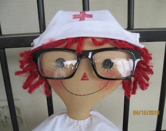 Primitive Nurse Annie with eye chart