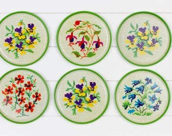 Set of six (6) metal coasters with print of embroidered flowers