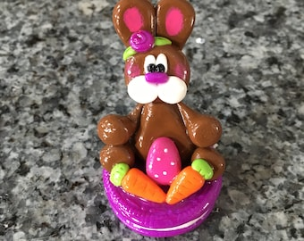 Polymer Clay Chocolate Easter Bunny sitting on a Cookie