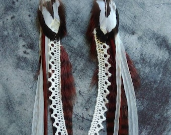 Pair of long feather earrings