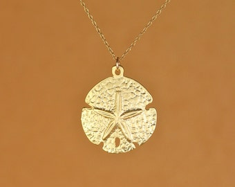Sand dollar necklace - sea star - beach necklace - starfish necklace - a gold vermeil sand dollar hanging from a 14k gold vermeil chain