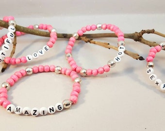 word-name elasticated bangles- in pink and silver with white word beads,5 word variations to choose from.funny, humour,