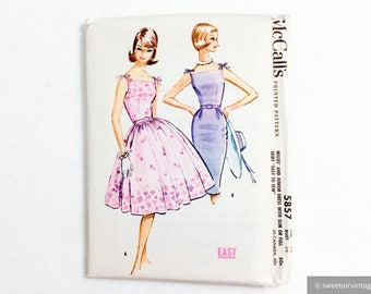 """unused uncut early 1960s printed dress pattern * shoulder bows + full or fitted skirt * McCall's 5857 * vintage size 14 bust 34"""" waist 26"""""""