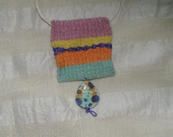 Cotton and ceramic pendant frame