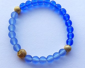 Blue Glass Gold Buddha Stretch Bracelet