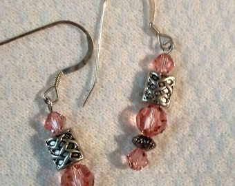 Rose peach Swarovski crystal and sterling silver pierced earrings with Celtic knot beads.