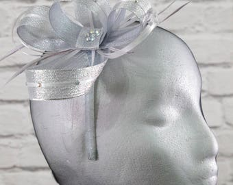 Metallic silver fascinator with  sparkling diamante' on a comb, Alice band or clip.