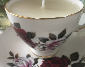 Colclough red rose teacup and saucer with rose scented candle.