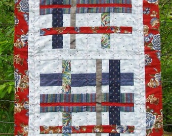 Red and blue cross-hatch table or bed runner