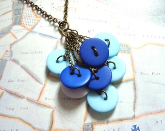 Bronze charm necklace blue and white buttons