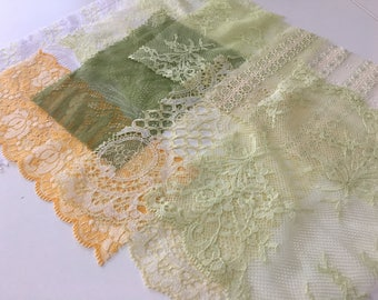 assortment of various smaller sheer lingerie tulle lace / mesh swatches — light green / yellow  — different sizes and patterns