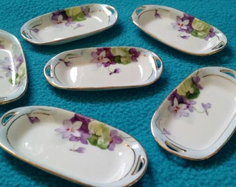 Hand Painted Nippon miniature porcelain trays (6) with violet motif and gold trim