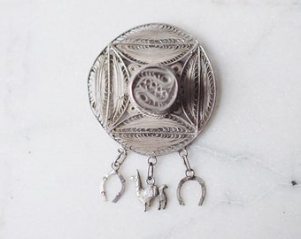 Vintage Peruvian Silver Filigree Hat Brooch with Llama and Horse Shoe Charms