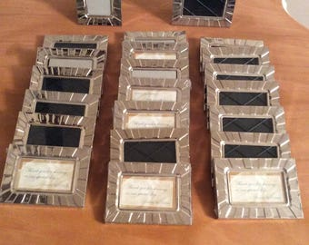 """Set of twenty two 3""""x4"""" silver colored decorative picture frames / wedding table number placement frames"""