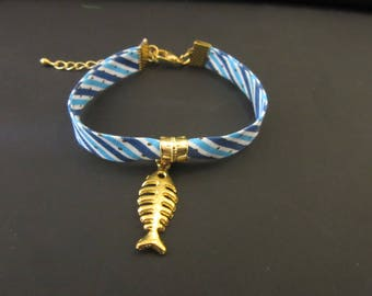 Blue fabric strap and gold fish