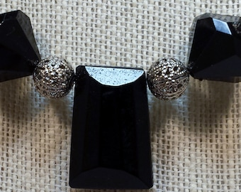 Black and silver necklace & earring set.