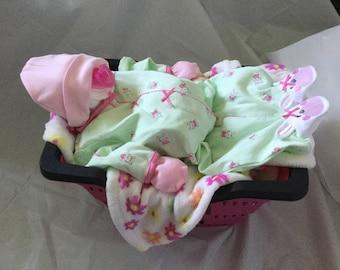 Sleeping Diaper Baby in Basket with bunny sleeper