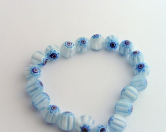 5 blue white glass beads flower Motif.