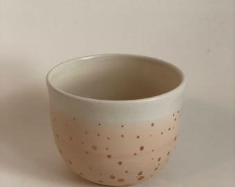 handmade bowl in peach and gold