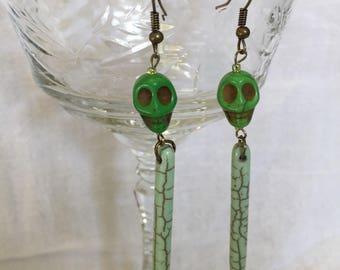 Green skull and spiky earrings