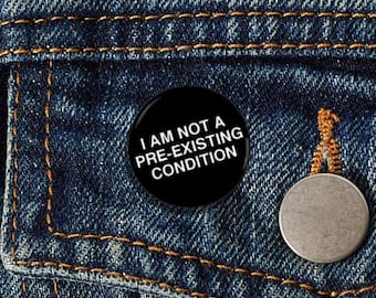 "I Am Not A Pre-Existing Condition Plain 1"" pinback button"