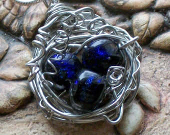 wire wrapped birdnest with dichroic bead lampwork eggs pendant necklace