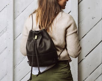 Leather Bucket Bag convertible to backpack: The Lagoa Convertible Bag in Black by Awl Snap