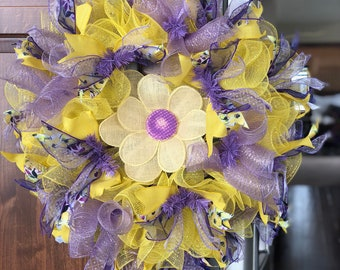A simple spring and summer wreath with purples and yellows