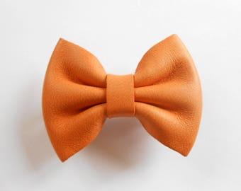 Hair clip orange leather of 5.5 x 4 cm