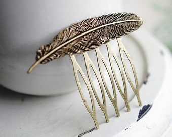 Detailed brass feather hair comb