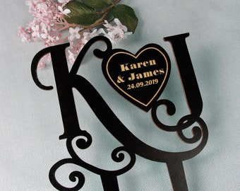 The Intitals personolisated Cake Topper with Bride and Grooms names avaible if 4 diffrent colours