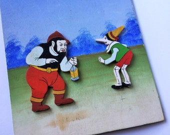 Pinocchio such relief painting-Painting in relief of the tale of Pinocchio, Pinocchio and fire eaters