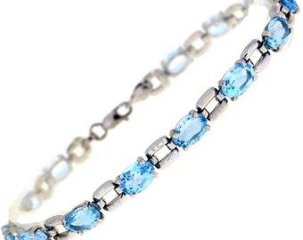 Genuine 5.18 Ctw Genuine Blue Topaz Bracelet In Sterling Silver