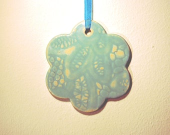 Ceramic flower ornament - large, turquoise and with lace pattern.