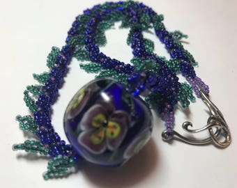 Kim Miles pansy lampwork glass focal bead on beaded spiral rope necklace
