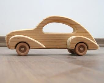 Elegant toy car made of wood