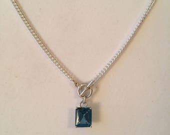 Emerald cut glass pendant in bright blue
