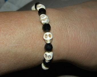 Skull Bracelet, Ceramic Skull Beads, and Faceted, Black Beads, Beaded Bracelet, Stretch Bracelet, Gothic, Rocker, Biker, Rock and Roll