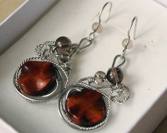 Earrings with a tiger's eye and topaz